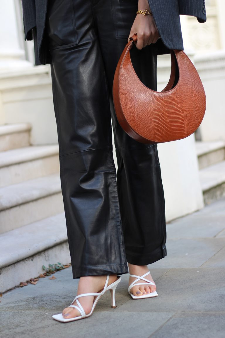 accessorized loose fit leather pants