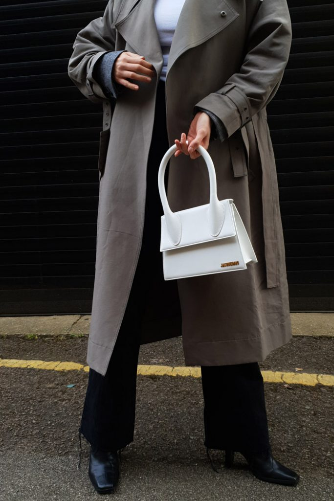 trench coat look styled with jacquemus bag