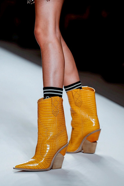 fendi orange cowboy boots on runway