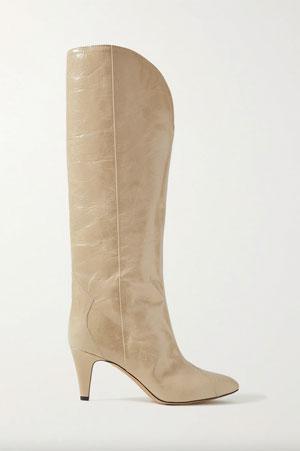 cream knee high cowboy boots on mid-heel