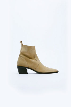 beige ankle boots with black sole