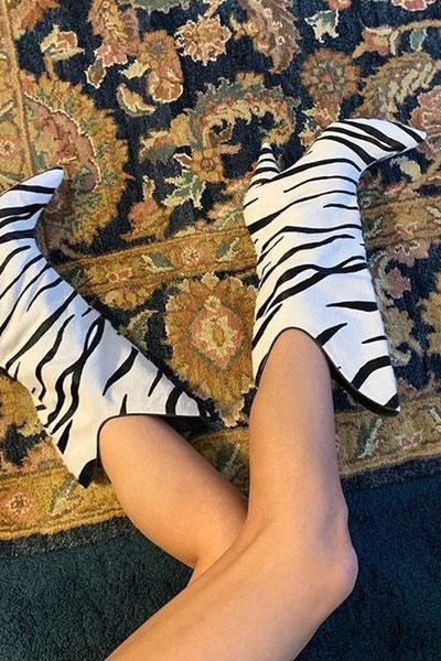 zebra cowboy boots on the floral carpet