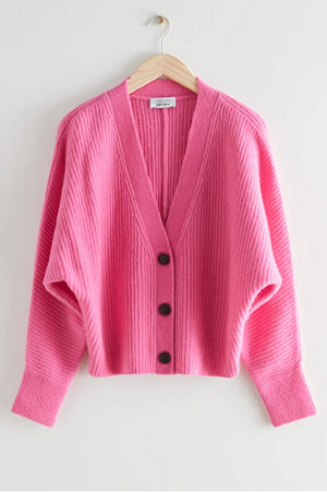 Autumn-Winter 2021 trends pink cardigan with black buttons
